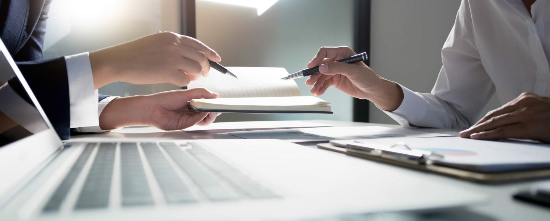 Man and woman sharing ideas at a desk